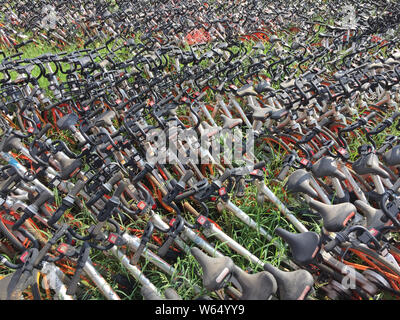 In this aerial view, thousands of bicycles of Chinese bike-sharing service mobike are lined up at a open space in Wuhan city, central China's Hubei pr - Stock Photo