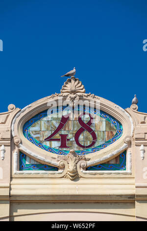 Architectural detail of a stained glass decorative number 48 from an Art Nouveau building in Viareggio, Tuscany, Italy. - Stock Photo