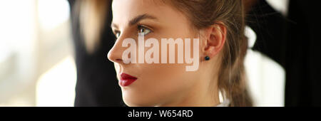 Young Woman Client Getting Haircut in Beauty Salon - Stock Photo