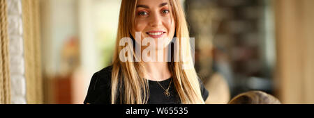 Young Hairdresser Holding Hair of Female Client - Stock Photo