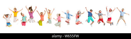 The kids in multicolored clothes jumping and selebrating red nose day on white studio background. Creative collage. Children look happy, wondered, playful, astonished, emotional. - Stock Photo