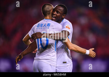 Belgian football player Yannick Ferreira Carrasco, left, of Dalian Yifang celebrates with his teammate Zimbabwean football player Nyasha Mushekwi afte - Stock Photo
