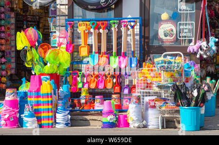 Lyme Regis, Dorset, UK. 31st July 2019. UK Weather: Bright and sunny morning at Lyme Regis. Bright coloured buckets and spades on sale outside a shop at the seaside resort of Lyme Regis. Credit: Celia McMahon/Alamy Live News. - Stock Photo