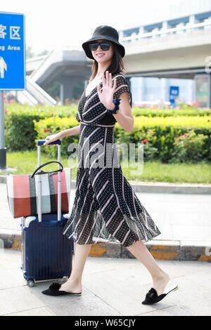 Chinese model and actress Zhang Zilin arrives at the Beijing Capital International Airport in Beijing, China, 1 August 2018. - Stock Photo