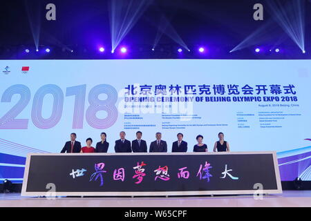 Officials and guests attend the opening ceremony of the 2018 Olympic Expo marking the 10th anniversary of the 2008 Beijing Olympic Games at the Beijin - Stock Photo
