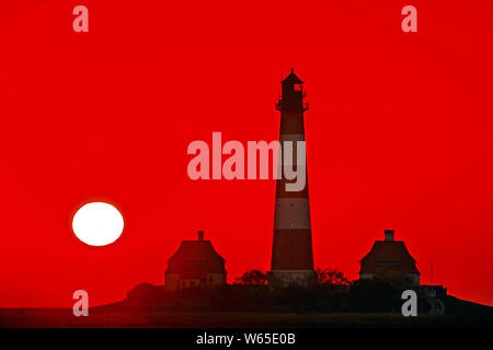 Lighthouse Westerhever, sunset, landmark of Eiderstedt peninsula, Westerhever, Schleswig-Holstein, Germany - Stock Photo