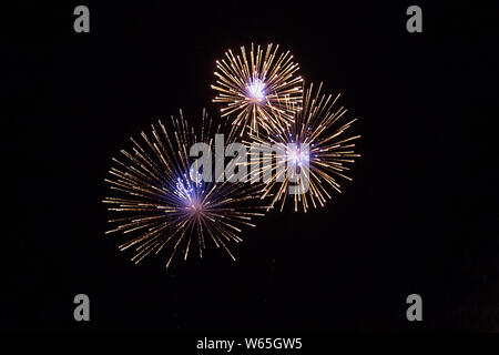 Low Angle View of firework display against black sky - Stock Photo