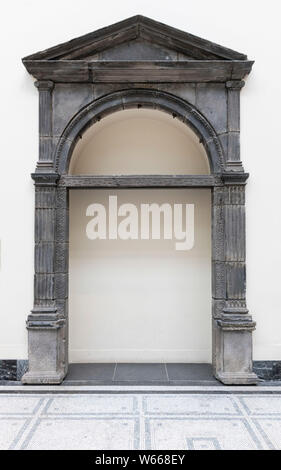 Volcanic stone arched doorway 1557 -  V & A Museum, Paul & Jill Ruddock Gallery  Cromwell Road, London SW7 UK - Stock Photo