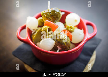 spanish banderillas, skewers with pickling olives, garlic, pickles, onion and red pepper, tapas - Stock Photo