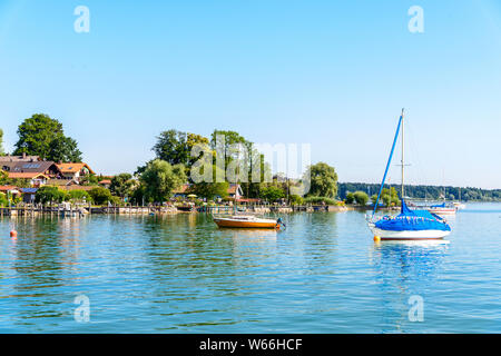 View on Chiemsee from Fraueninsel, Frauenchiemsee with boats, Sailboats.    Bavaria, Bayern, Germany - Stock Photo
