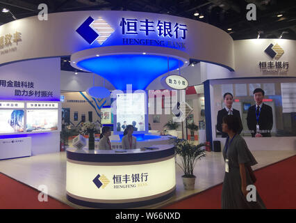 A visitor walks past the stand of Hengfeng Bank during an expo in Beijing, China, 18 July 2018.   Jiang Xiyun, former president of national commercial - Stock Photo