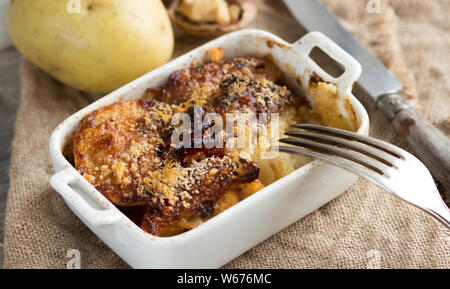 Codfish with potatoes cooked in the oven - Stock Photo