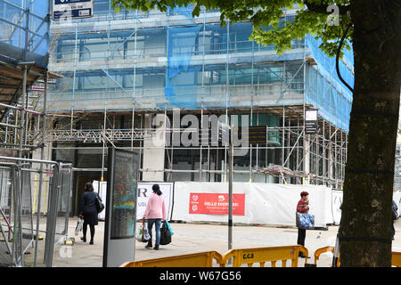 Scaffolding pictured on the outside of a city centre building in Swansea, UK. - Stock Photo