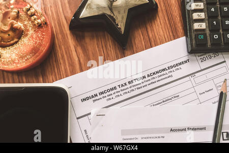 Close up of Indian Income tax return form ITR-2 return form is on the table next to a pen, calculator and a home mortgage loan application form placed - Stock Photo
