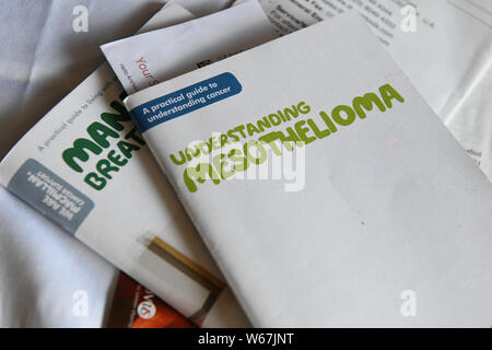 Pictured are leaflets by Macmillan Cancer Support about Mesothelioma. - Stock Photo