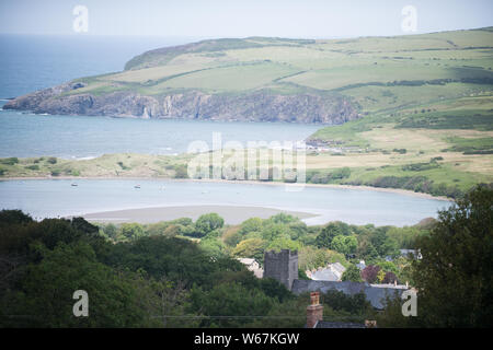 A general view of the beach at the seaside village of Newport in Pembrokeshire, Wales, popular with tourist to the Pembrokeshire area. - Stock Photo