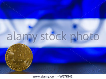 Bitcoin golden coin with Honduras flag on background - Stock Photo