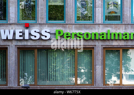 Frankfurt, Germany - July 06, 2019: The logo of the group Weiss Human resource management at an office building on 06 July 2019 in Frankfurt. - Stock Photo