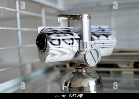 Classic flip clock on a metal stand in the interior.The theme of time and punctuality. - Stock Photo