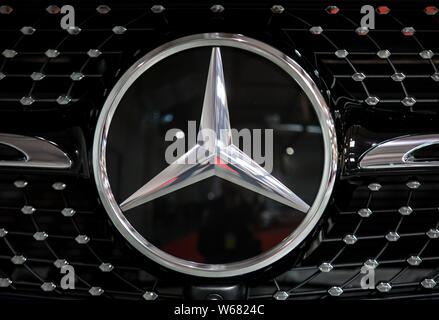 Cracow, Poland - May 18, 2019: Mercedes C-HR metalic logo closeup on the Mercedes  car displayed at Moto Show in Cracow Poland. - Stock Photo