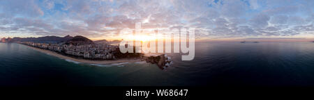 Sunrise 360 degree full panoramic aerial view of Rio de Janeiro with Arpoador and Ipanema beach in the foreground and the wider cityscape behind - Stock Photo