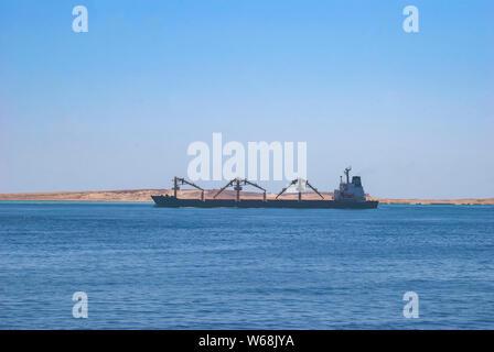 A cargo ship sailing near the Sinai Peninsula in Egypt - Stock Photo