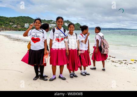 Filipino Schoolgirls On Their Way Home From School, Bulabeg Beach, Boracay, The Philippines - Stock Photo