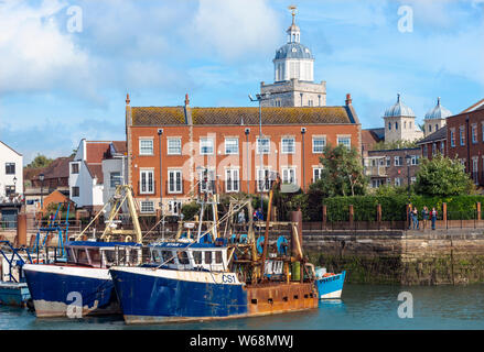Fishing boats moored in Camber Docks with the Cathedral Tower in the background  at Old Portsmouth, Hampshire, England, United Kingdom, EU - Stock Photo