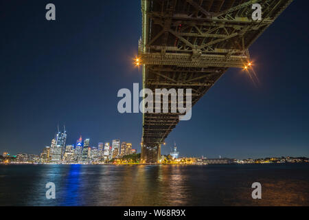 The Sydney Harbour Bridge is a heritage-listed steel through arch bridge across Sydney Harbour that carries rail, vehicular, bicycle, and pedestrian t