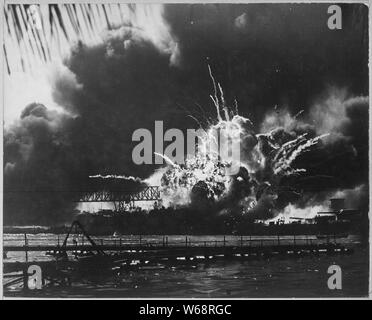USS SHAW exploding during the Japanese raid on Pearl Harbor, T.H.; General notes:  Use War and Conflict Number 1135 when ordering a reproduction or requesting information about this image. - Stock Photo