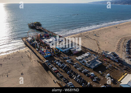 Santa Monica, California, USA - December 17, 2016:  Afternoon aerial view of famous Santa Monica Pier and beach on the Los Angeles County coast. - Stock Photo