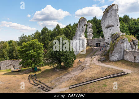 PODZAMCZE, POLAND - July 15, 2019: Rocks with ruins of Ogrodzieniec Castle in Polish Jurassic Highland, Silesia region of Poland, Europe - Stock Photo