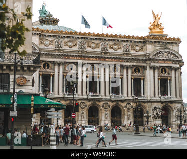 Paris, France-JULY 19, 2014: View on the Opera National de Paris and street with cafe. Grand Opera (Opera Garnier) is famous neo-baroque building in P - Stock Photo