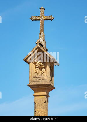 The top of the Medieval Town Cross in the Market Square in Stow on the Wold, Gloucestershire, England, UK. - Stock Photo