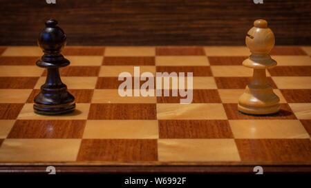 Black vs. White on chessboard - Stock Photo