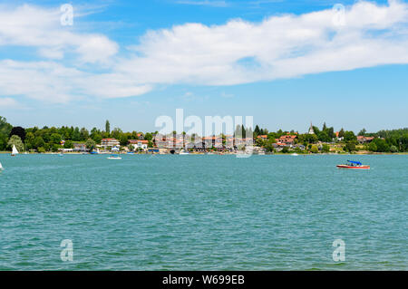 View on lake Chiemsee with a boat, Sailboat on Gstadt from Fraueninsel, Frauenchiemsee.  Bavaria, Bayern, Germany - Stock Photo