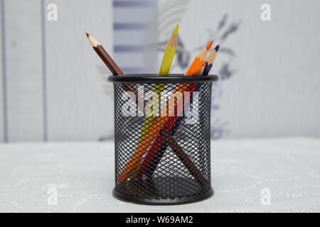 Box for pens and pencils . Colored pencils in a pencil case on white background . Color pencils in black case on white background isolated . Creative - Stock Photo