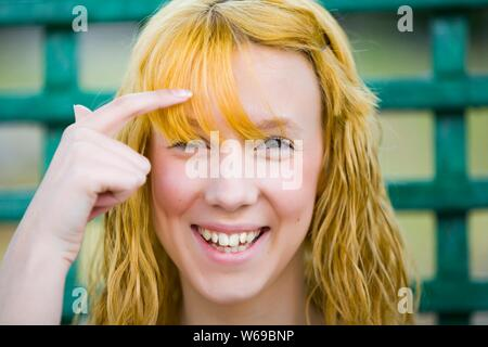 Who's blond in here? ordinary teen teenager girl next door headshot portrait facing looking at camera eye contact smile smiling giggling giggle happy - Stock Photo