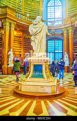 VIENNA, AUSTRIA - MARCH 2, 2019: The marble sculpture of Emperor Charles Vi in typical Roman clothes located in main Hall of National Libratry, on Mar - Stock Photo