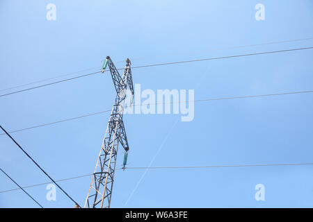 Transmission towers, pylons, power towers, adapted for high voltage electricity transportation and distribution, abiding by French regulation, with a Stock Photo