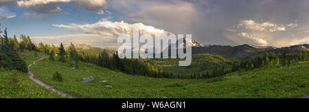 Dramatic Stormy Sky and Wide Panoramic Landscape of Healy Pass Meadows on great summertime hiking trail, Canadian Rocky Mountains, Banff National Park - Stock Photo