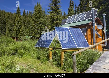 Outdoor Solar Panels in Alpine Meadow by Brewster Shadow Lake Lodge, Banff National Park Canadian Rocky Mountains - Stock Photo