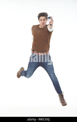 Man running with mobile phone - Stock Photo