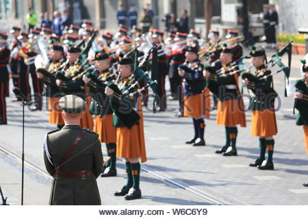 A military parade has taken place in Dublin to commemorate the 1916 Rising. President Michael D Higgins lead a wreath in front of the GPO the building - Stock Photo