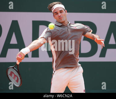 Swiss tennis player Roger Federer playing  a forehand shot in French Open 2019 tennis tournament, Paris, France - Stock Photo