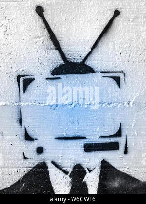 Addicted man holding vintage tv instead of head. Television manipulation and brainwashing concept. Mass media propaganda control. - Stock Photo