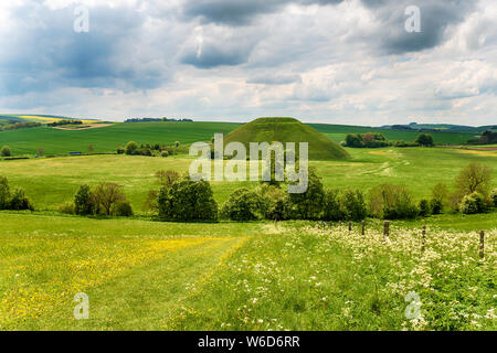 The mysterious Silbury Hill near Avebury in the Wiltshire countryside - Stock Photo