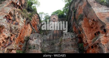 The Leshan Giant Buddha or Leshan Grand Buddha near Chengdu. This is the tallest stone Buddha statue in the world. Leshan Buddha, Sichuan. UNESCO - Stock Photo