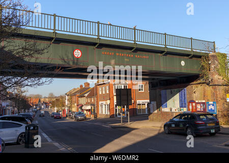 Historic Great Western Railway rail bridge across the High Street in the town centre of Hungerford, a historic market town in Berkshire, England - Stock Photo