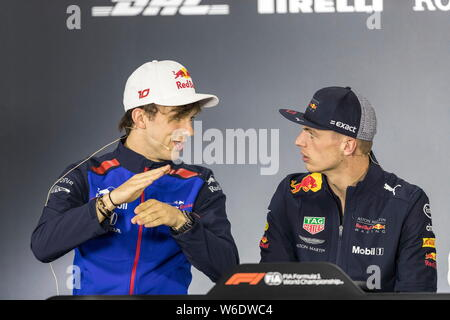 French F1 driver Pierre Gasly of Scuderia Toro Rosso, left, and Dutch F1 driver Max Verstappen of Red Bull Racing attend a press conference before the - Stock Photo